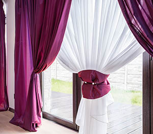 Elegant curtain and purple drapes in luxury residence