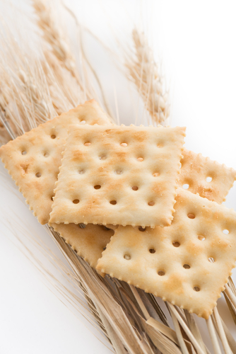 cookies crackers biscuits sprinkled and wheat with sesame on a white background.